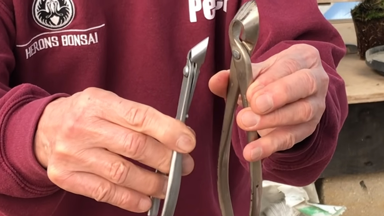 close up of Peter holding narrow blade cutter and concave cutter